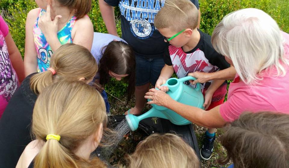 SPROUTS Youth Garden Club and their composter at Extension Office